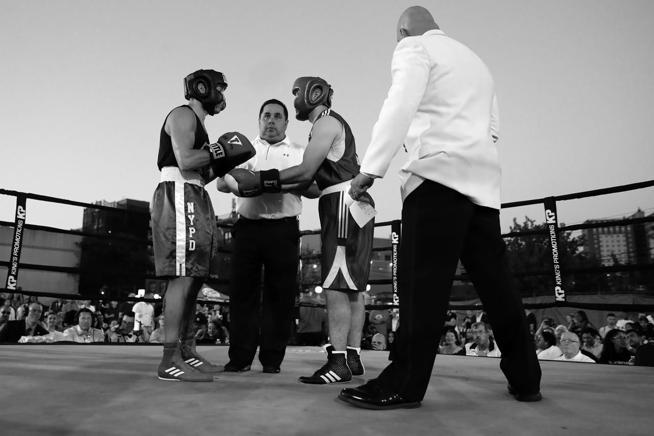 <p>Blue Glove Boxing Academy's Craig Ratcliffe and NYPD officer Hugh Herbert are given the rules by the referee before bout at the 'Brooklyn Smoker' in the parking lot of Gargiulo's Italian Restaurant in Coney Island, Brooklyn on Aug. 23, 2018. (Photo: Gordon Donovan/Yahoo News) </p>