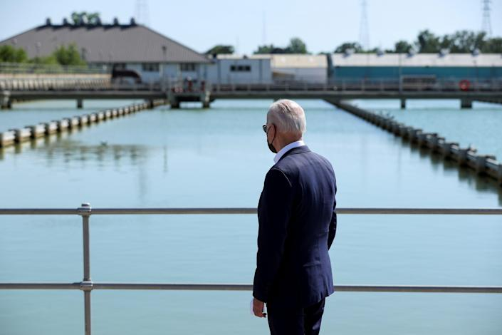 <p>Joe Biden looks out at the New Orleans Sewerage & Water Board's facility on 6 May.</p> (REUTERS)