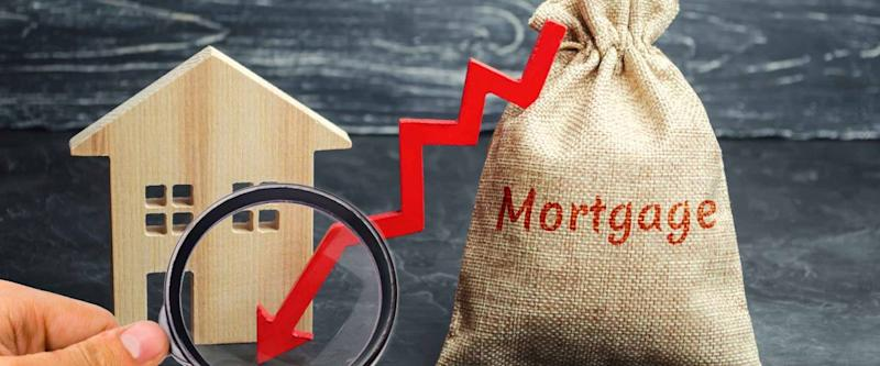 Bag with the money and the word Mortgage and arrow. Falling mortgage rates