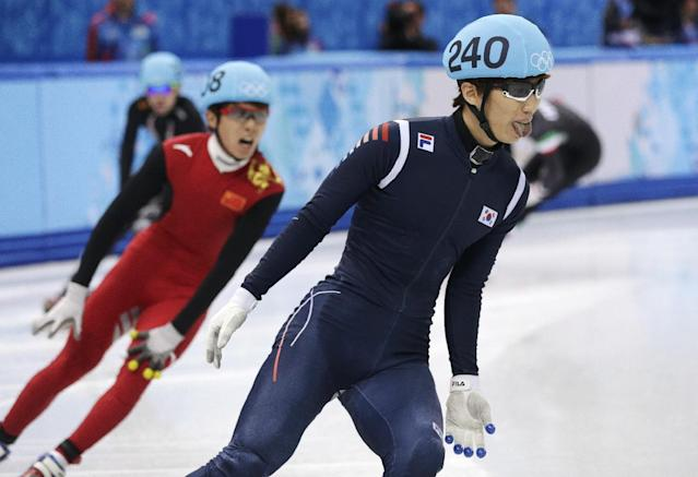 Lee Han-bin of South Korea sticks his tongue out after competing in a men's 1500m short track speedskating heat at the Iceberg Skating Palace during the 2014 Winter Olympics, Monday, Feb. 10, 2014, in Sochi, Russia. (AP Photo/Darron Cummings)