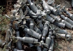 PTAB 2.5 bomblets piled in a munitions dump in Bagram, Afghanistan in 2002. Dozens of countries, though not Syria, Russia or the U.S., are signatories to the Convention on Cluster Weapons, which bars their use. Image Source: John Rodsted, courtesy of the Cluster Munition Coalition
