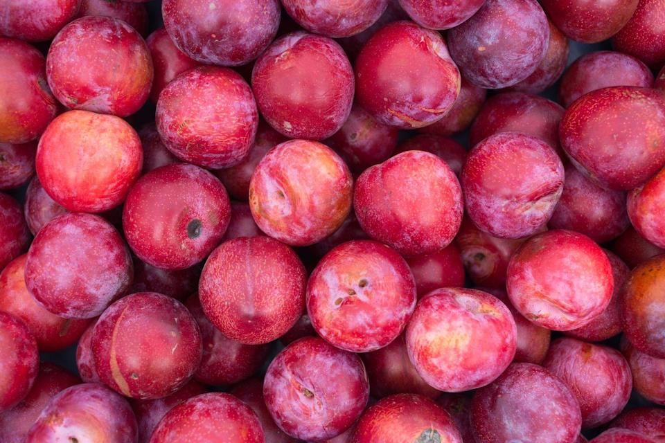 """<p>Plums have <a href=""""https://www.ncbi.nlm.nih.gov/pubmed/26992121"""" rel=""""nofollow noopener"""" target=""""_blank"""" data-ylk=""""slk:been shown"""" class=""""link rapid-noclick-resp"""">been shown</a> to have anti-inflammatory benefits that may help to boost <a href=""""https://www.goodhousekeeping.com/health/diet-nutrition/g1370/foods-that-boost-brain-health/"""" rel=""""nofollow noopener"""" target=""""_blank"""" data-ylk=""""slk:cognition"""" class=""""link rapid-noclick-resp"""">cognition</a>. Choose dried prunes for even more calcium and magnesium, which have been linked to decreasing your risk of <a href=""""https://www.goodhousekeeping.com/health/diet-nutrition/a35340894/10-surprising-sources-of-calcium/"""" rel=""""nofollow noopener"""" target=""""_blank"""" data-ylk=""""slk:osteoporosis"""" class=""""link rapid-noclick-resp"""">osteoporosis</a>. Or when you're grilling chicken or a steak, throw on some halved fresh plums—the heat intensifies their sweetness. </p>"""