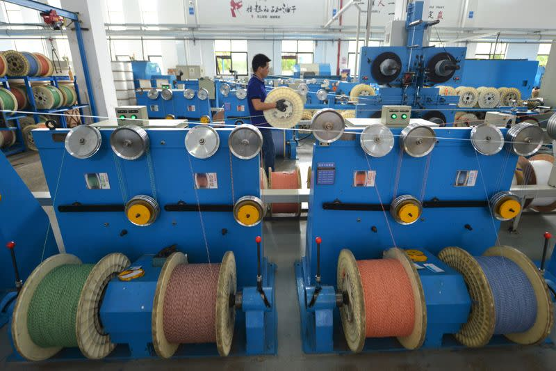 Employee works at a factory of the Zhejiang Headway Communication Equipment Co in Huzhou