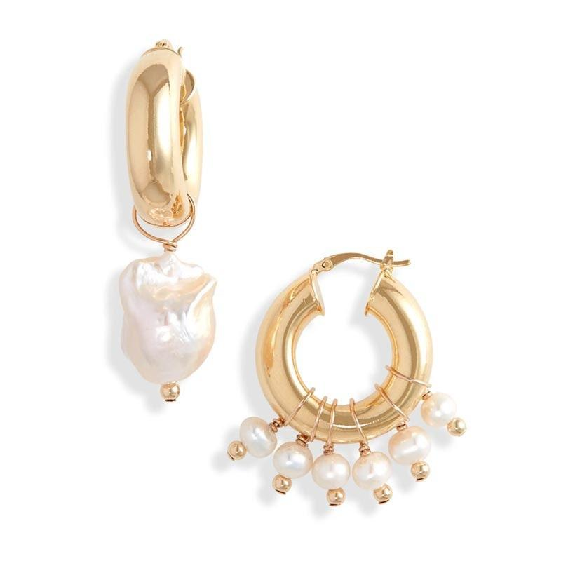 "Worn together or alone, these <a href=""https://www.glamour.com/gallery/pearl-jewelry-trend?mbid=synd_yahoo_rss"" rel=""nofollow noopener"" target=""_blank"" data-ylk=""slk:baroque pearl hoops"" class=""link rapid-noclick-resp"">baroque pearl hoops</a> are guaranteed to be their new favorite accessory. $175, Nordstrom. <a href=""https://www.nordstrom.com/s/eliou-enzo-mismatched-baroque-pearl-charm-hoops/5698638"" rel=""nofollow noopener"" target=""_blank"" data-ylk=""slk:Get it now!"" class=""link rapid-noclick-resp"">Get it now!</a>"