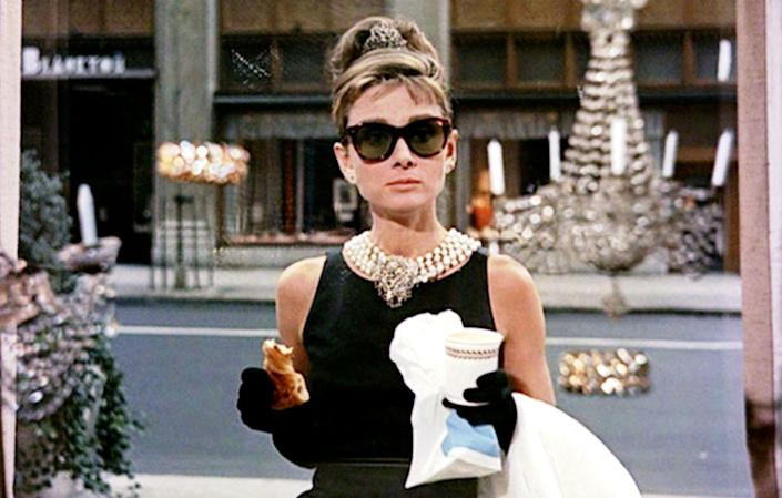 <p>Audrey Hepburn's jewelry in <em>Breakfast at Tiffany's </em>were the pearls seen around the world<em>. </em>The actress wore a multiple strand pearl necklace clasped with a large diamond brooch for the iconic opening scene of the film. </p>