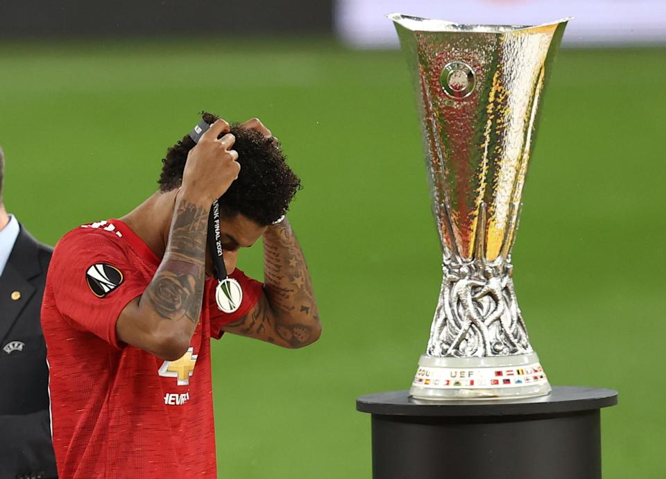 Soccer Football - Europa League Final - Villarreal v Manchester United - Polsat Plus Arena Gdansk, Gdansk, Poland - May 26, 2021 Manchester United's Marcus Rashford looks dejected as he walks past the Europa League trophy with his runners up medal after the match Pool via REUTERS/Maja Hitij
