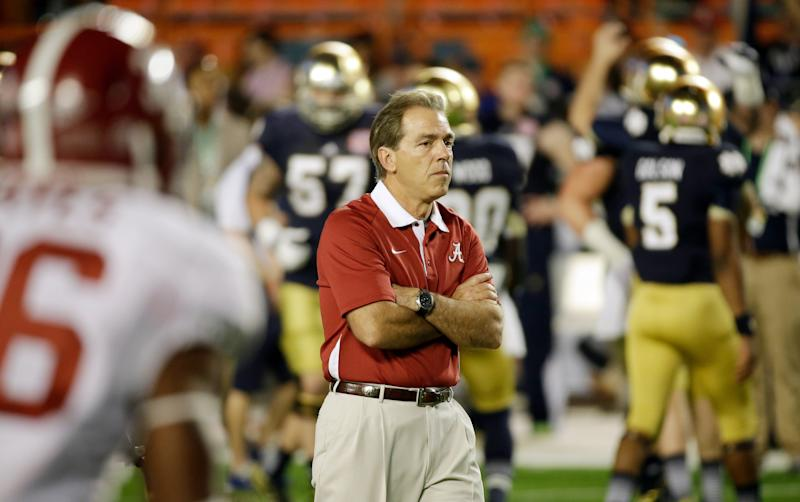Alabama head coach Nick Saban watches as players warm up before the BCS National Championship college football game against Notre Dame Monday, Jan. 7, 2013, in Miami. (AP Photo/David J. Phillip)