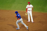 New York Mets' Robinson Cano, left, rounds the bases past Philadelphia Phillies third baseman Alec Bohm after hitting a home run off Philadelphia Phillies pitcher Spencer Howard during the third inning of a baseball game, Friday, Aug. 14, 2020, in Philadelphia. (AP Photo/Matt Slocum)