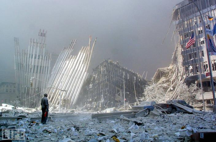 """Like a scene from an uneasy dream, Doug Kanter's picture of a man standing amid the seemingly endless World Trade Center rubble, calling out for survivors, brings to mind the sense so many of us shared on 9/11 and in the days and weeks after: What, in the face of such annihilation, can one person do? """"I was on autopilot after the first tower fell,"""" Kanter told LIFE.com. After briefly taking shelter, he stepped outside into streets that """"were pretty much deserted, and that's when the person in the picture emerged. He looked like he might be a maintenance worker, had a fire extinguisher in his hand, and was calling out to see if anyone could hear him, saying they should make noise, and people would come and help."""" Not long after Kanter took this photo, a police office hustled him away from the spot. Minutes later, the second tower collapsed. <br><br>(Photo: DOUG KANTER/AFP/Getty Images)<br><br>For the full photo collection, go to <a href=""""http://www.life.com/gallery/59971/911-the-25-most-powerful-photos#index/0"""" rel=""""nofollow noopener"""" target=""""_blank"""" data-ylk=""""slk:LIFE.com"""" class=""""link rapid-noclick-resp"""">LIFE.com</a>"""