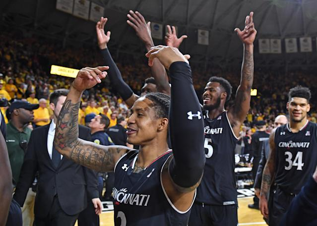 Cincinnati Bearcats players celebrate after beating the Wichita State Shockers for the AAC title. (Getty Images)