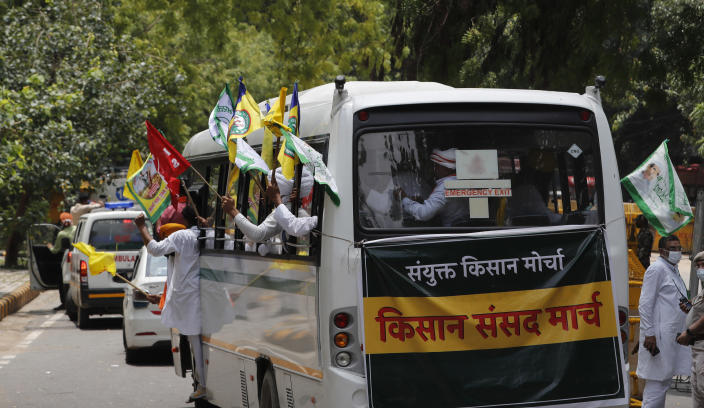 Indian farmers arrive at a protest site to hold mock farmer's parliament in New Delhi, India, Thursday, July 22, 2021. More than 200 farmers on Thursday began a protest near India's Parliament to mark eight months of their agitation against new agricultural laws that they say will devastate their income. (AP Photo/Manish Swarup)