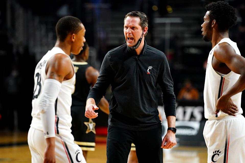John Brannen instructs Cincinnati Bearcats players during a game against Vanderbilt on March 4 at Fifth Third Arena in Cincinnati.