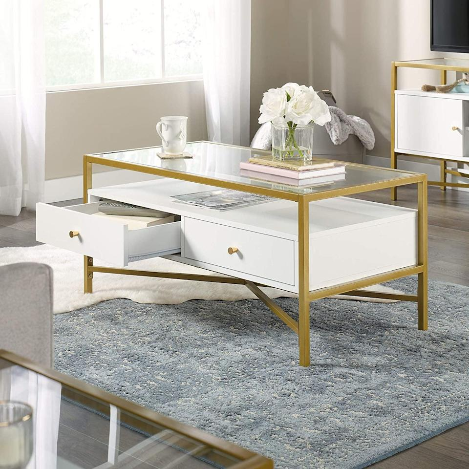 <p>The <span>Sauder Harper Heights White Contemporary Glass-Top Coffee Table</span> ($183, originally $205) is both a modern piece of decor and an elevated storage solution. </p>