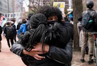 Patricia Kugmeh (L) and Trinity Shaw (R) embrace in Minneapolis after the verdict in the Derek Chauvin trial