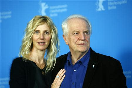 """Cast members Sandrine Kiberlain (L) and Andre Dussollier pose during a photocall to promote the movie """"Aimer, Boire Et Chanter"""" (Life of Riley) at the 64th Berlinale International Film Festival in Berlin February 10, 2014. REUTERS/Thomas Peter"""