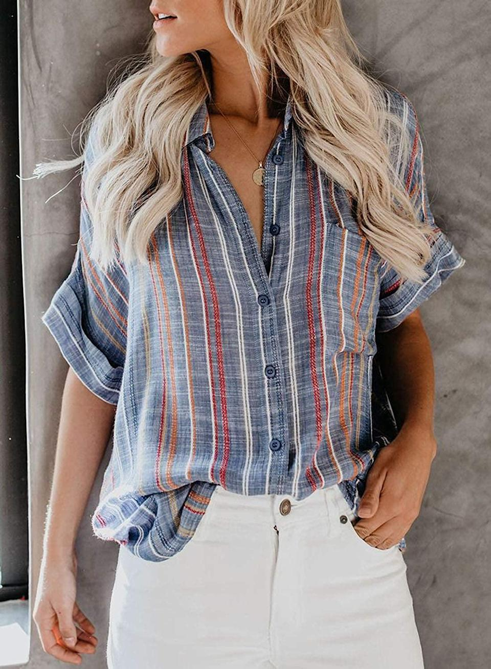 <p>You need this cool <span>Hotapei Casual V-Neck Blouse</span> ($23).</p>
