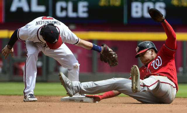 Washington Nationals' Juan Soto, right, steals second base as Atlanta Braves shortstop Dansby Swanson, left, tries to tag him during the fourth inning of a baseball game Saturday, Sept. 15, 2018, in Atlanta. (AP Photo/John Amis)