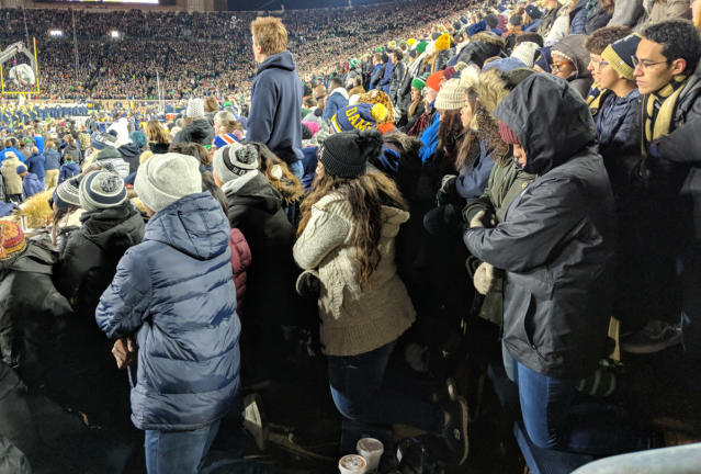 "A group of Notre Dame students kneel during the playing of the national anthem prior to Saturday's game in South Bend. (Courtesy of <a href=""https://ndsmcobserver.com/2018/11/students-kneel-during-national-anthem/"" rel=""nofollow noopener"" target=""_blank"" data-ylk=""slk:Andrew Cameron/The Observer"" class=""link rapid-noclick-resp"">Andrew Cameron/The Observer</a>)"