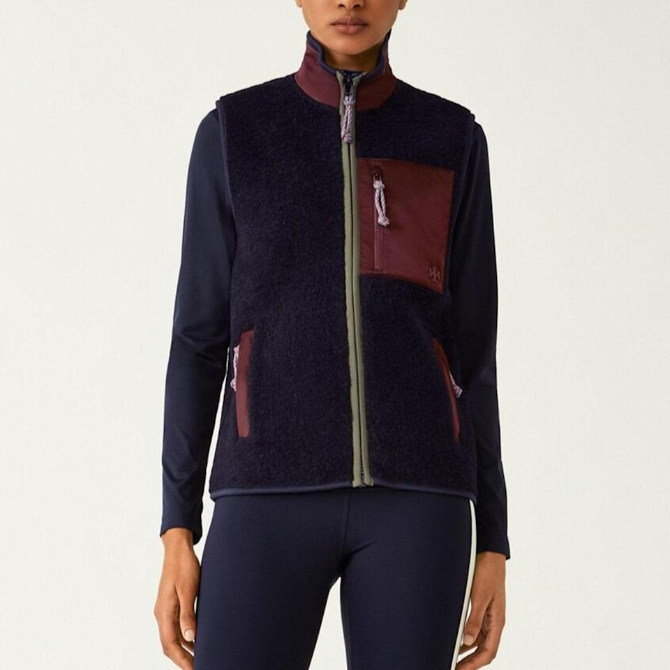 """Why bother with sleeves when you have this chic vest to zip up over all your knits? $278, Tory Burch. <a href=""""https://www.toryburch.com/en-us/clothing/jackets/fleece-zip-vest/80670.html?color=416"""" rel=""""nofollow noopener"""" target=""""_blank"""" data-ylk=""""slk:Get it now!"""" class=""""link rapid-noclick-resp"""">Get it now!</a>"""