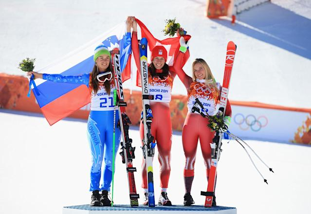 SOCHI, RUSSIA - FEBRUARY 12: (L-R) Gold medalist Tina Maze of Slovenia, gold medalist Dominique Gisin of Switzerland and bronze medalist Lara Gut of Switzerland celebrate on the podium during the flower ceremony for during the Alpine Skiing Women's Downhill on day 5 of the Sochi 2014 Winter Olympics at Rosa Khutor Alpine Center on February 12, 2014 in Sochi, Russia. (Photo by Richard Heathcote/Getty Images)