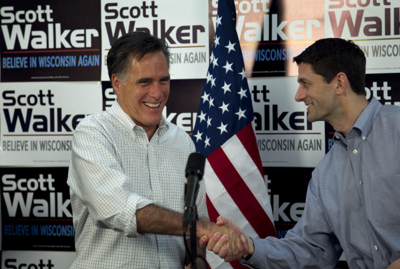 Republican presidential candidate, former Massachusetts Gov. Mitt Romney, left, shakes hands with U.S. Rep. Paul Ryan, R-Wis., Chairman of the House Budget Committee, right, before speaking with supporters of Wisconsin Republican Gov. Scott Walker at a phone bank during a campaign stop in Fitchburg, Wis., Saturday, March 31, 2012.  The phone bank is used in support of Walker who is facing a recall election in June 2012. (AP Photo/Steven Senne)