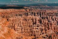 """<p><a href=""""https://www.nps.gov/brca/index.htm"""" rel=""""nofollow noopener"""" target=""""_blank"""" data-ylk=""""slk:Bryce Canyon National Park"""" class=""""link rapid-noclick-resp"""">Bryce Canyon National Park</a> won't look like anywhere you've seen before with thousands of their hoodoos — geological structures formed by frosty weather and steam erosion. You'll be looking out into a sea of red, orange, and white rocks — and be sure to check out a collection of natural amphitheaters, too. </p><p>Bryce Canyon is located about 50 miles from Zion National Park.</p><p>How many of these did you know was in the United States? Each of these places is a real-life Photoshopped dream. You won't have to fly across the world to see any of these unreal destinations. Some you can check off your list in one road trip from Arizona, Utah, and California. </p><p>Wherever your next adventure takes you, you won't have to leave the country to see wonders of the world. </p>"""