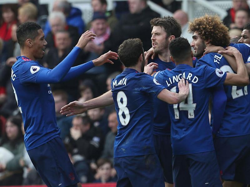 United's players celebrate the opening goal (Getty)