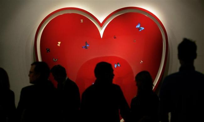 "Visitors view Damien Hirst's ""All You Need Is Love"" at Sotheby's auction house in central London December 5, 2007."