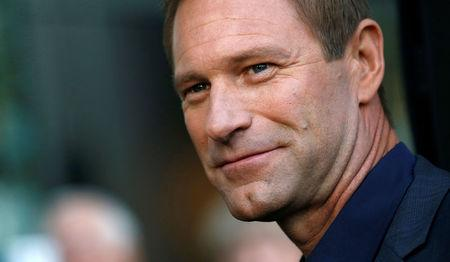 """Cast member Aaron Eckhart poses at the premiere of """"Sully"""" in Los Angeles, California U.S., September 8, 2016.   REUTERS/Mario Anzuoni"""