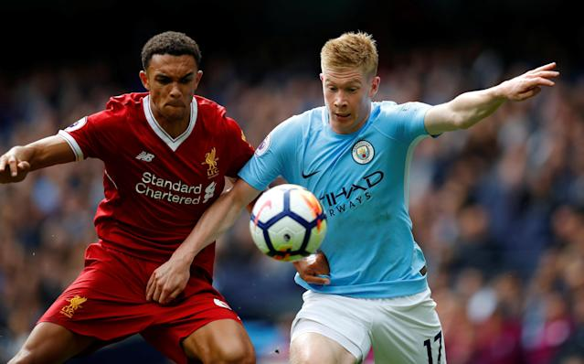 <p>Manchester City's Kevin De Bruyne takes on Liverpool's Trent Alexander-Arnold </p>
