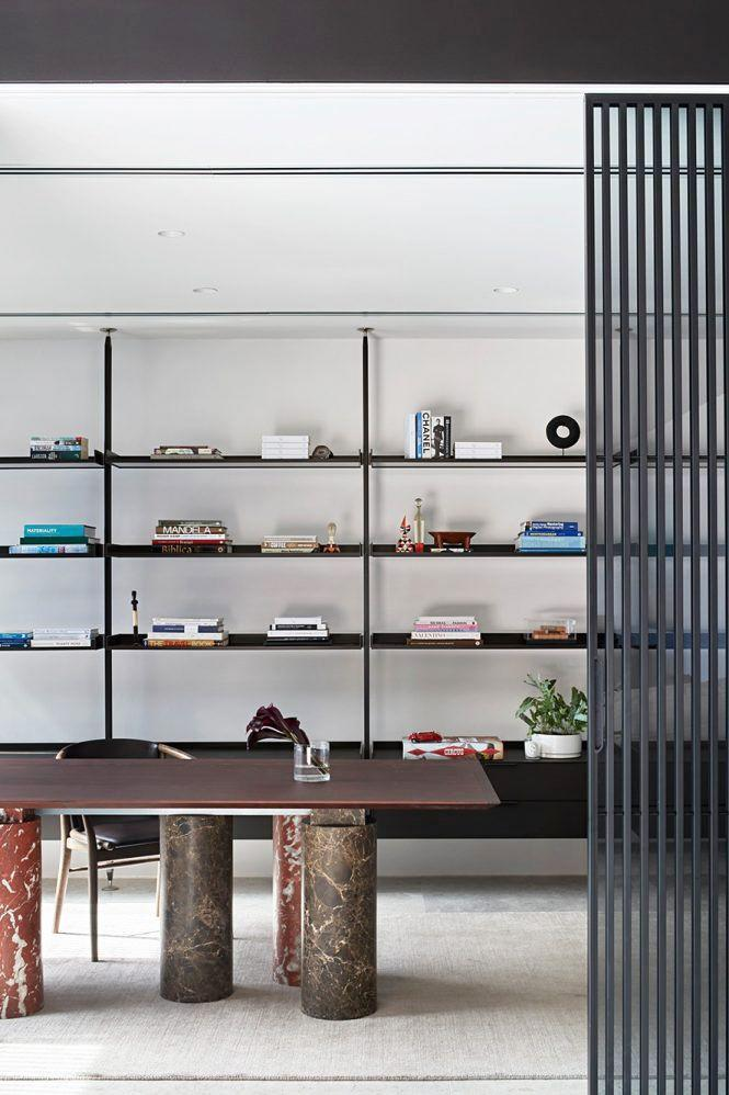 <p>This home office designed by Australian design firm Hecker Guthrie is so cool, it's almost intimidating. But, hey, if that's the vibe you're going for in a modern home office and you feel most at ease against ultra-modern backdrops, more power to you. From the nature-inspired materials and streamlined modular shelving that keep things running smoothly, this is the formula for modern elegance. </p>