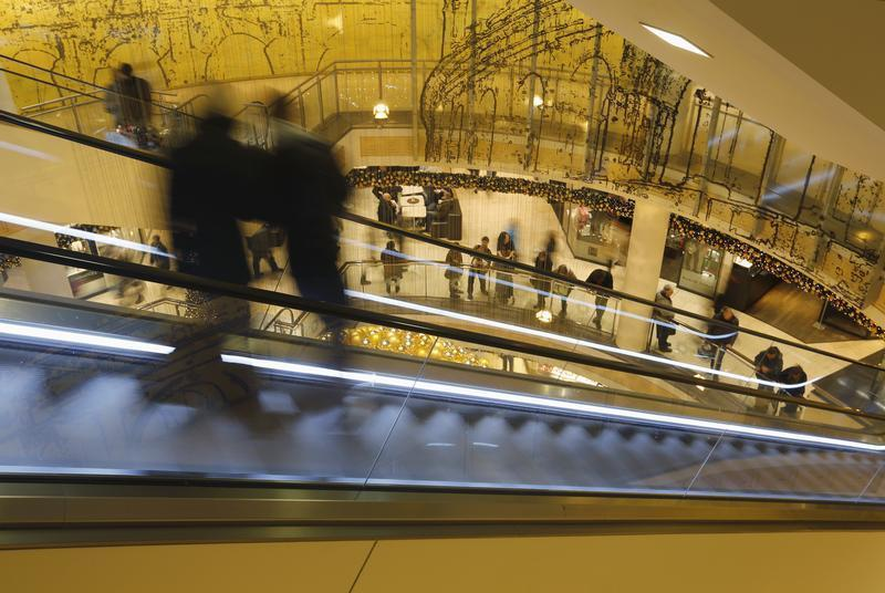 People use an escalator at a shopping mall in Essen