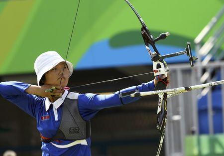 Kang Un Ju (PRK) of North Korea competes in Women's Individual 1/32 Eliminations in archery at the 2016 Rio Olympics, August 9, 2016. REUTERS/Leonhard Foeger