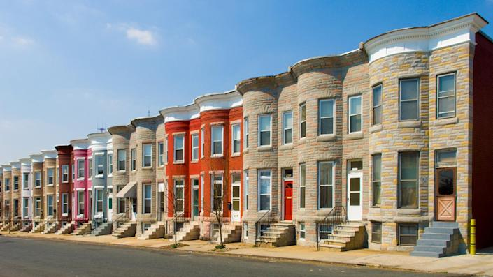 Colorful row houses along a sunny residential street.