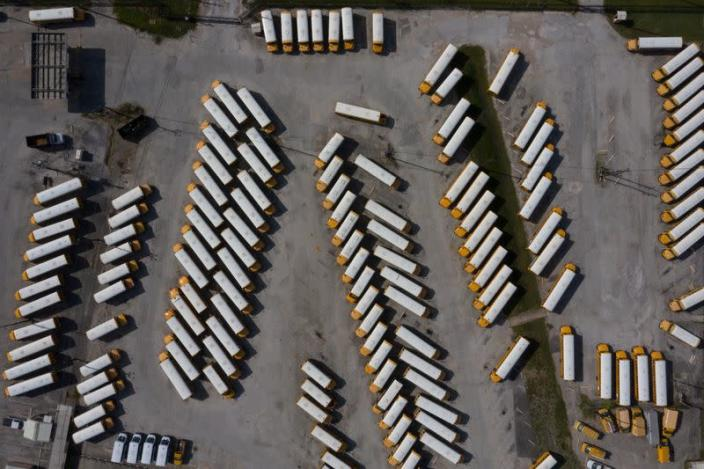 Empty school buses are seen in parking lot amid global outbreak of the coronavirus disease (COVID-19) in Houston, Texas