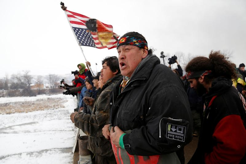 <p>Raymond Kingfisher, 59, of the Northern Cheyenne Tribe, sings during a march on the outskirts of the main opposition camp against the Dakota Access oil pipeline near Cannon Ball, North Dakota, U.S., February 22, 2017. (Terray Sylvester/Reuters) </p>