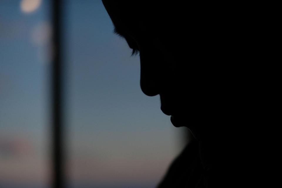 A silhouette of a child's face