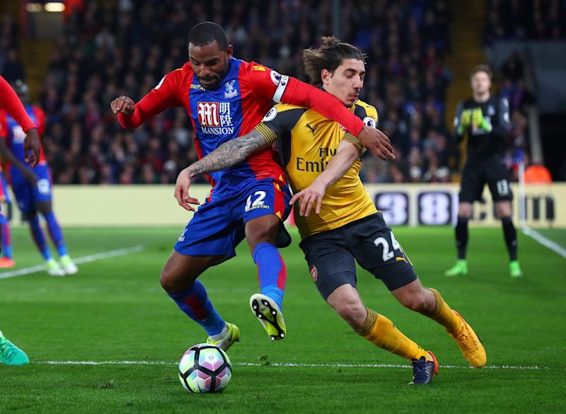 Jason Puncheon of Crystal Palace tussles with Hector Bellerin of Arsenal during the Premier League match between Crystal Palace and Arsenal at Selhurst Park