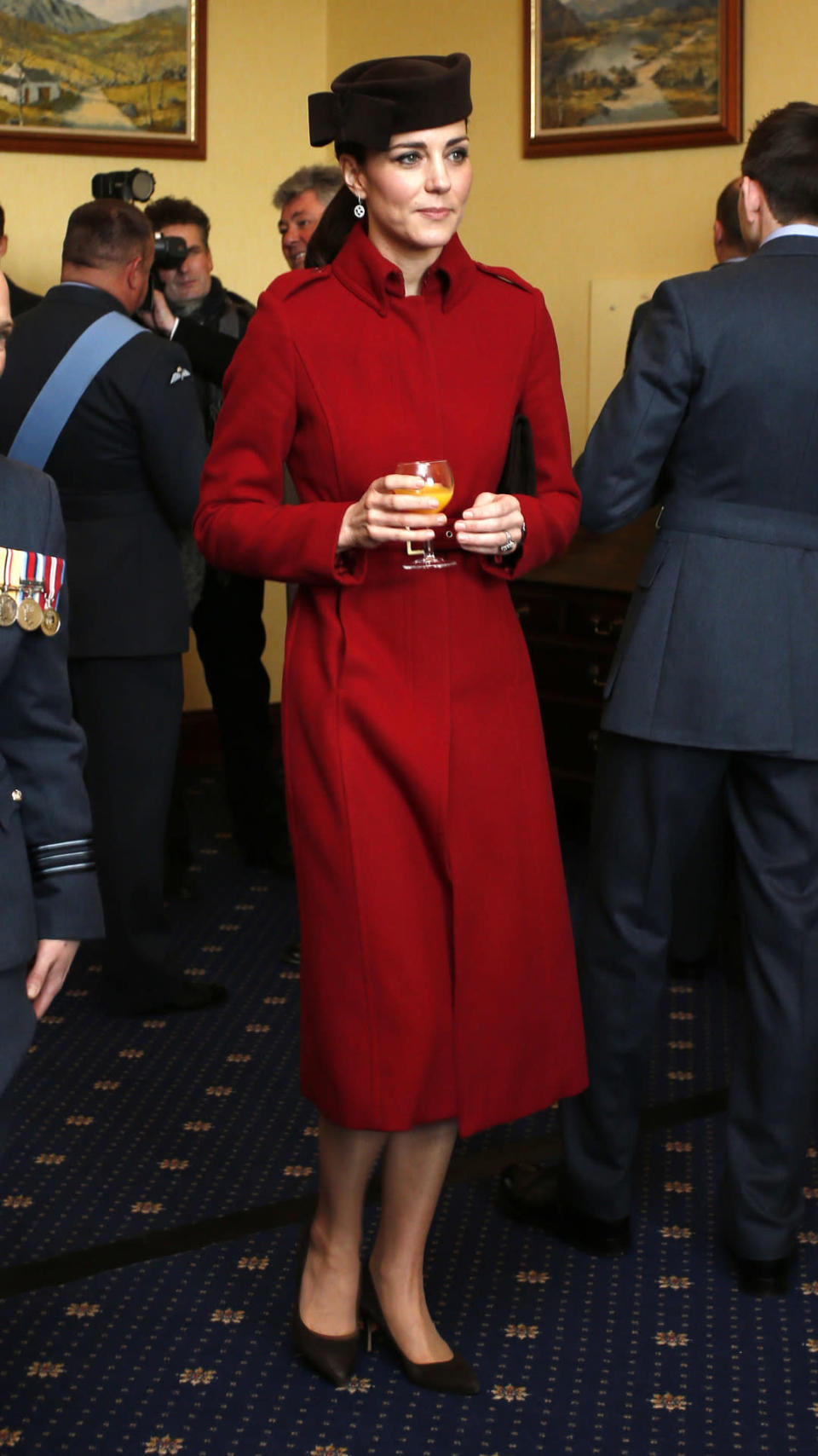 <p>Kate's RAF trip to Wales featured a fitted red coat by favoured retailer L.K. Bennett and a chic black hat designed by Lock & Co Hatters.</p><p><i>[Photo: PA]</i></p>