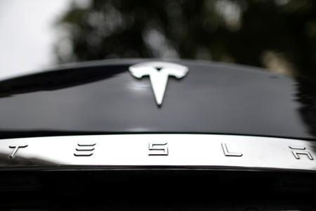 Tesla electric car catches fire after hitting tow truck in Moscow