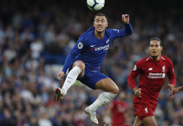 Chelsea's Eden Hazard heads the ball during the English Premier League soccer match between Chelsea and Liverpool at Stamford Bridge stadium in London, Saturday, Sept. 29, 2018. (AP Photo/Frank Augstein)