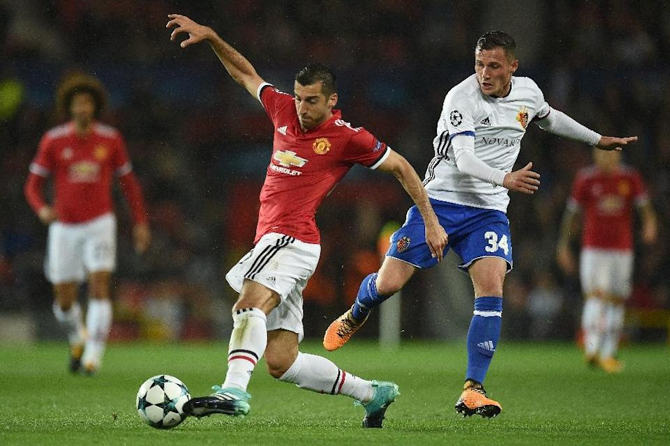 Manchester United's Henrikh Mkhitaryan (L) fights for the ball with Basel's Taulant Xhaka during their UEFA Champions League Group A match, in Manchester, on September 12, 2017 (AFP Photo/Oli SCARFF )