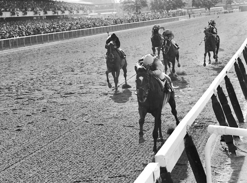 FILE - In this June 7, 1969, file photo, Arts and Letters and jockey Braulio Baeza, front, passes Majestic Prince and jockey Bill Hartack, left, to win the Belmont Stakes horse race at Belmont Park in Elmont, N.Y. Hartack was criticized by many for moving too late in the stretch in the loss to Arts and Letters. As I'll Have Another prepares to attempt to win the Belmont Stakes in his quest to become the 12th Triple Crown champion and first in 34 years on Saturday, June 9, 2012, The Associated Press takes a look at some of the 19 horses who won the Kentucky Derby and the Preakness, but came up short in the final leg of the Triple Crown, and how the race unfolded. (AP Photo, File)