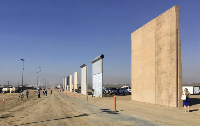 <p>People look at prototypes of a border wall Thursday, Oct. 26, 2017, in San Diego. (Photo: Elliott Spagat/AP) </p>