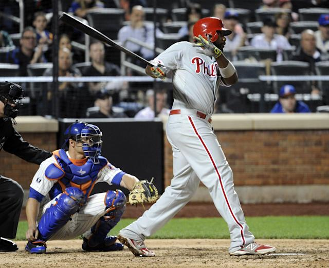 Philadelphia Phillies' Ryan Howard hits an RBI-single as New York Mets catcher Anthony Recker, left, looks on during the ninth inning of a baseball game Saturday, May 10, 2014, at Citi Field in New York. The Phillies defeated the Mets 5-4. (AP Photo/Bill Kostroun)