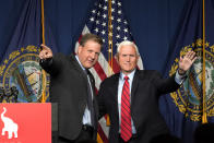Former Vice President Mike Pence, right, waves as N.H. Gov. Chris Sununu introduces him at the annual Hillsborough County NH GOP Lincoln-Reagan Dinner, Thursday, June 3, 2021, in Manchester, N.H. (AP Photo/Elise Amendola)