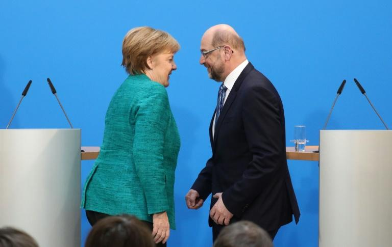 "Merkel and SPD leader Schulz have reached a deal for a new grand-left coalition, known in Germany as ""GroKo"""