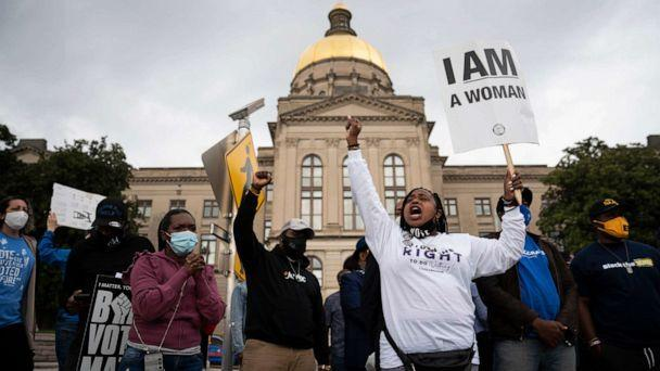 PHOTO: People protest outside the Georgia Capitol in Atlanta against a House bill on voting restrictions, March 25, 2021. (Nicole Craine/The New York Times via Redux)