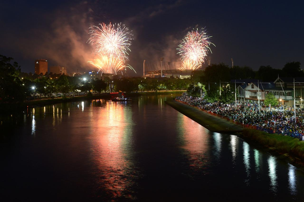 MELBOURNE, AUSTRALIA - DECEMBER 31: 9.30PM fireworks over The Melbourne Cricket Ground and Yarra River during New Years Eve fireworks on December 31, 2013 in Melbourne, Australia. (Photo by Vince Caligiuri/Getty Images)