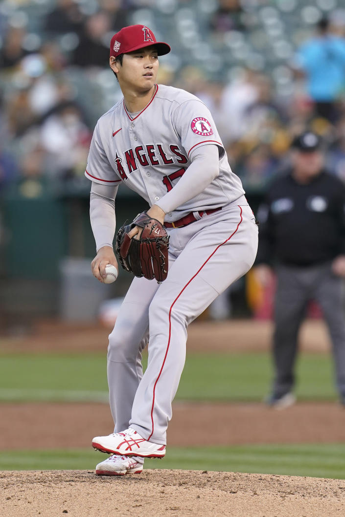 Los Angeles Angels' Shohei Ohtani pitches against the Oakland Athletics during the third inning of a baseball game in Oakland, Calif., Monday, July 19, 2021. (AP Photo/Jeff Chiu)